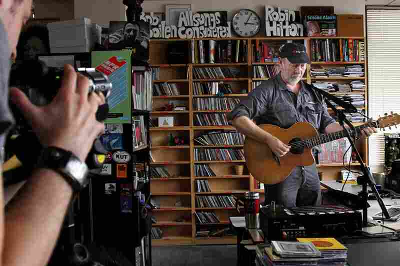 Richard Thompson stands behind Bob Boilen's desk while the cameras roll during his Tiny Desk Concert on October 19th.