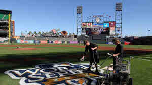 Groundskeepers at AT&T Park in San Francisco paint the World Series logo onto the field.