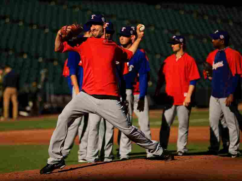 Texas Rangers' ace Cliff Lee throws during a workout session.
