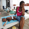 Sick victims and families wait