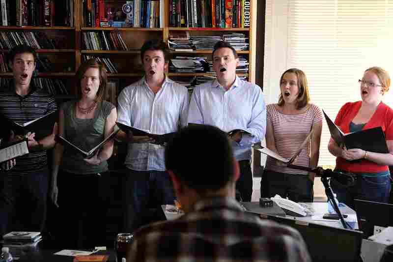 Members of the 12-person choral ensemble Stile Antico sing beautifully as NPR staff watch on October 15th.