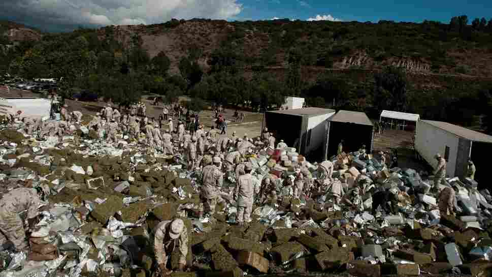Members of the Mexican Army arrange 134 tons of marijuana