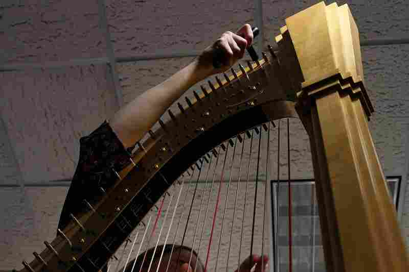 Yolanda Kondonassis tunes her harp before she performs a Tiny Desk Concet on October 12th.