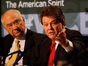 Phil Gramm (left) and Arthur Laffer argue for the motion