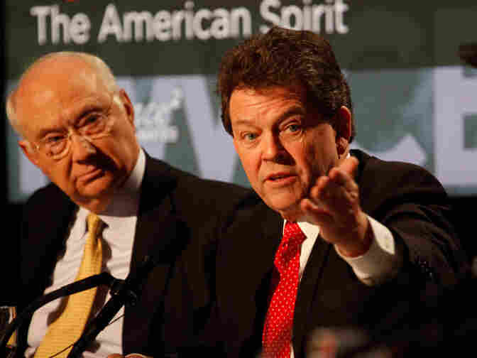 Phil Gramm (left) and Arthur Laffer argue for the motion