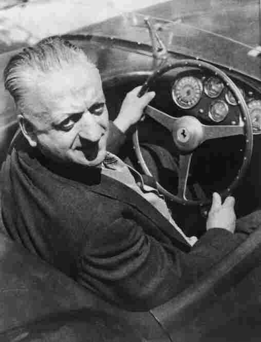 Enzo Ferrari, the Italian car designer, behind the wheel of one of his cars, April 1964