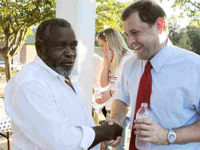 Rep. Tom Perriello (D-VA) (right) speaks to a potential voter.