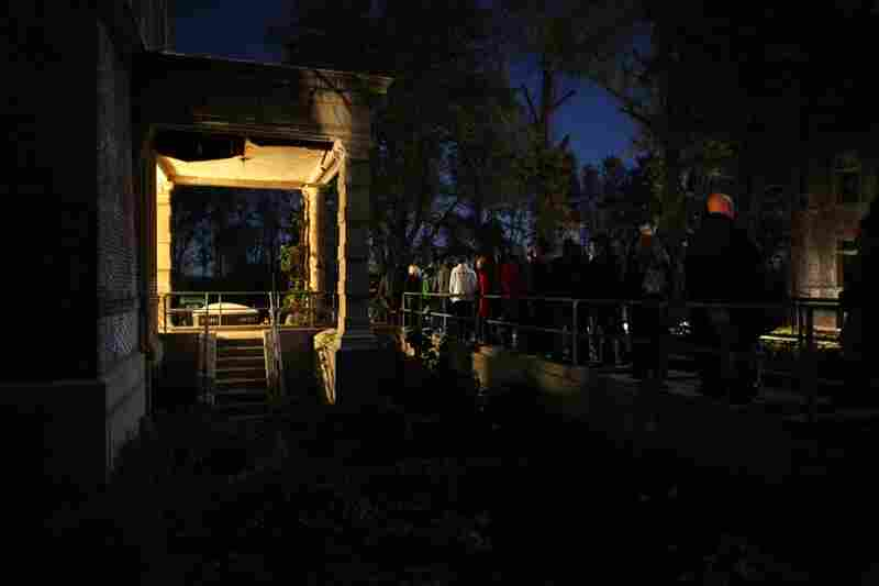 People wait in line on the catwalk to get into the Pennhurst Asylum. The tour features fake bodies, actors playing mental patients, a morgue, and a dark walk through underground tunnels.