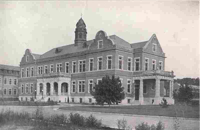 "Shown in a photograph from 1922, the administrative building now serves as the main building of the ""Pennhurst Asylym"" haunted house attraction."