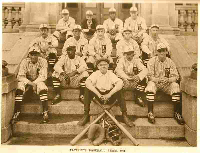 The patient's baseball team sits on the steps of a campus building in this 1925 photograph.