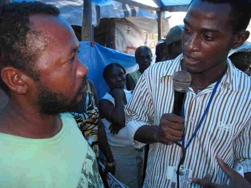 Jethro Sereme records for a radio broadcast at a tent camp in Haiti.