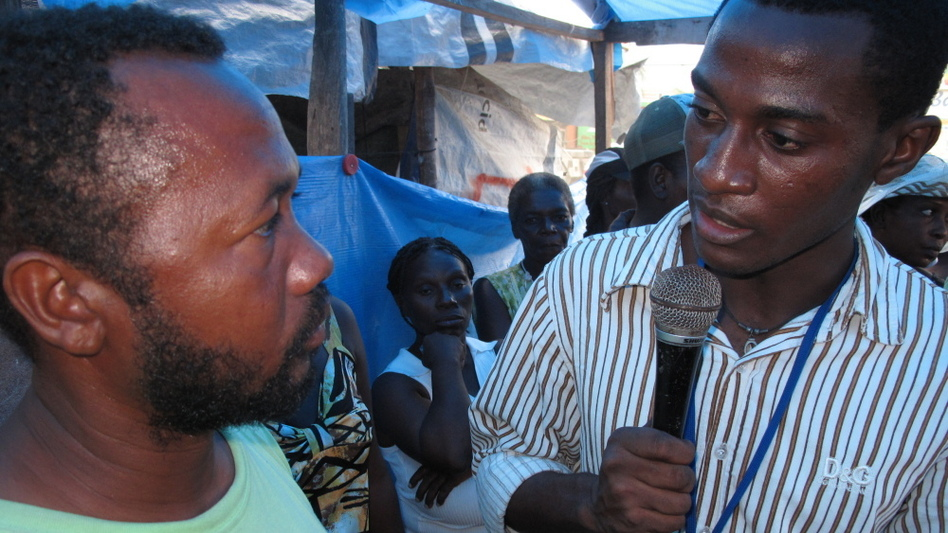 Jethro Sereme (right) is a student radio reporter whose cholera story will be broadcast to Haitians on 40 community radio stations. It's part of a cholera education effort by the International Organization for Migration.