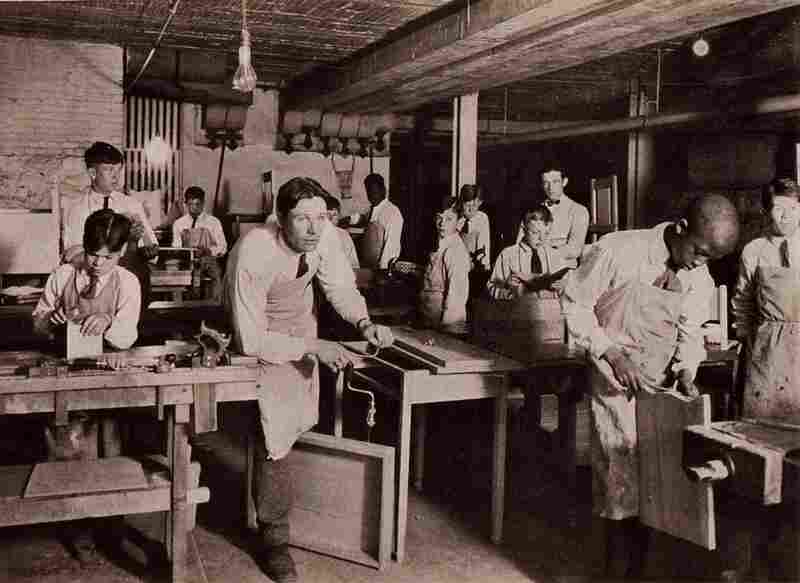 "Patients practice woodworking in this 1926 photograph. Other ""occupational therapy"" activities included sewing, upholstering, and printing."