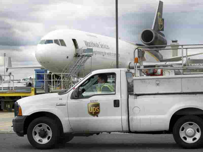 A UPS worker drives past a UPS plane at Liberty Airport in Newark, N.J., on Friday.