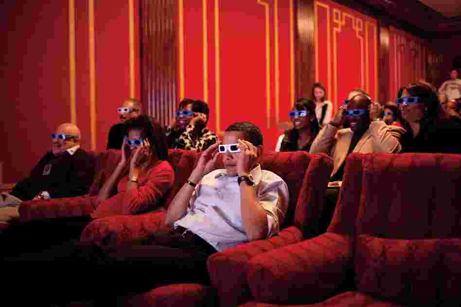 A few weeks after inauguration, President Obama, the First Lady, friends and members of Congress donned 3-D glasses while watching a commercial during Super Bowl XLIII in the family theater of the White House.