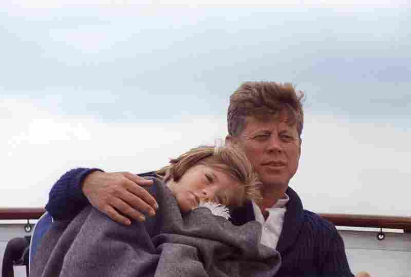 Cecil Stoughton's photographic coverage evolved from typical ceremonial images to fresher, documentary-style pictures like this one of John F. Kennedy and his daughter, Caroline, aboard a yacht in Hyannis Port, Mass., 1963.