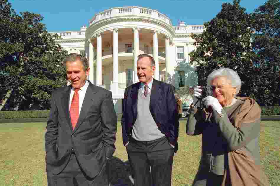 "George W. Bush's chief photographer, Eric Draper, caught Barbara Bush photographing George Bush Jr. and Sr. in Jan., 2001. ""One thing I learned right off the bat,"" Draper said, ""is that when you say, 'Mr. President,' they both turn around."""