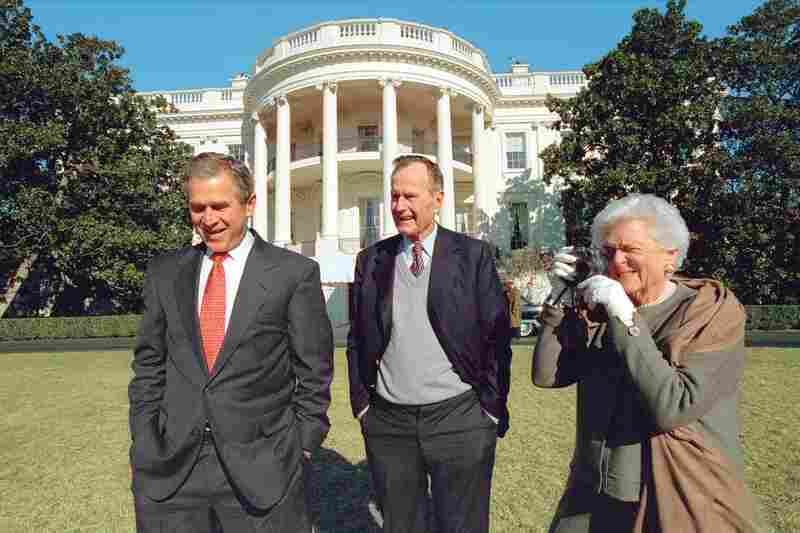"""George W. Bush's chief photographer, Eric Draper, caught Barbara Bush photographing George Bush Jr. and Sr. in Jan., 2001. """"One thing I learned right off the bat,"""" Draper said, """"is that when you say, 'Mr. President,' they both turn around."""""""