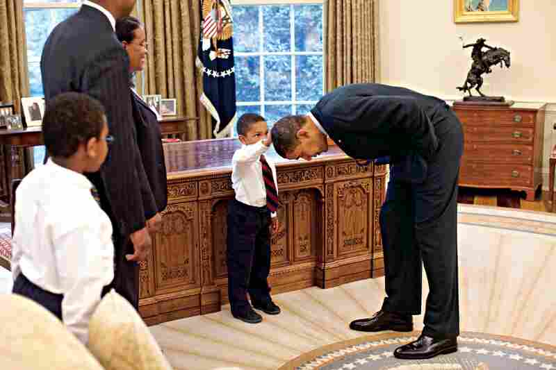 Pete Souza made this photo, which President Obama has said is one of his favorites, when White House staffer Carlton Philadelphia brought his family to meet the President. His son declared that he'd been told that he and the President had the same haircut. Obama bent over so the child could get a better look.