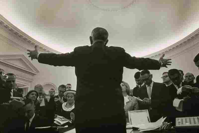 Lyndon B. Johnson's photographer Yoichi Okamoto disappeared behind the President to make this image.