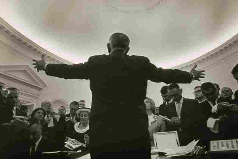 Lyndon B. Johnson's photographer Yoichi Okamoto disappeared behind the President to make this image.