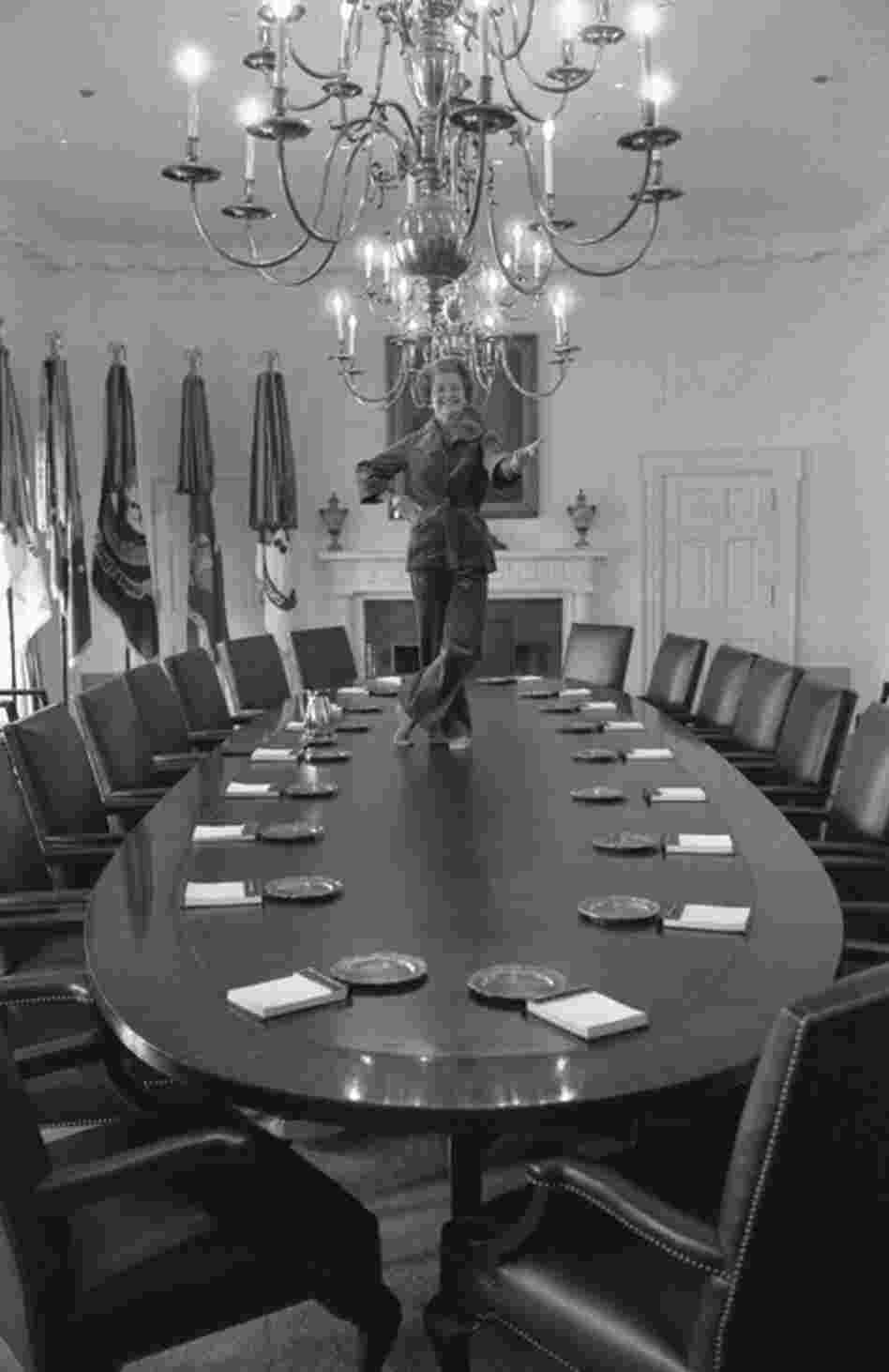 David Hume Kennerly made this picture the day before the Carters moved into the White House. Taking a last tour of the West Wing, Betty Ford told him she'd always wanted to dance on the Cabinet Room table. A former Martha Graham dancer, she slipped off her shoes, hopped on the table and struck a pose.