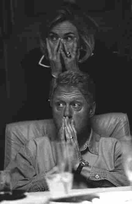 A number of Bob McNeely's images show President Clinton and the First Lady fully engaged on issues together, as in this moment when they are listening to a briefing on board Air Force One.