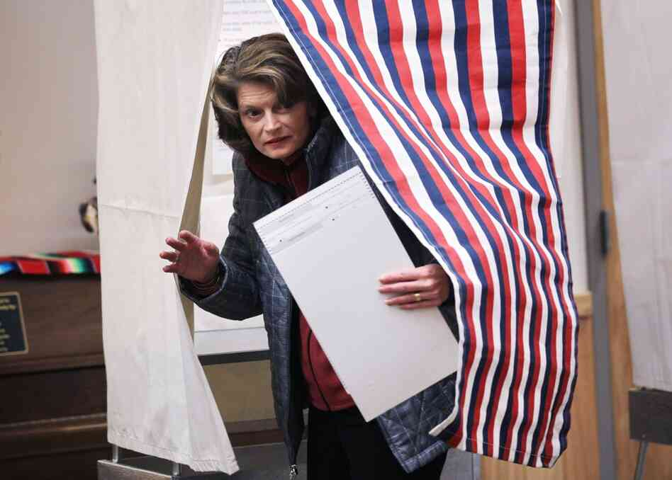 Sen. Lisa Murkowski emerges from a voting booth after filling out her ballot in Girdwood, Alaska. Murkowski is defending her Senate seat as a write-in candidate. If she wins, she would be the first successful write-in candidate for Senate since South Carolina's Strom Thurmond in 1954.