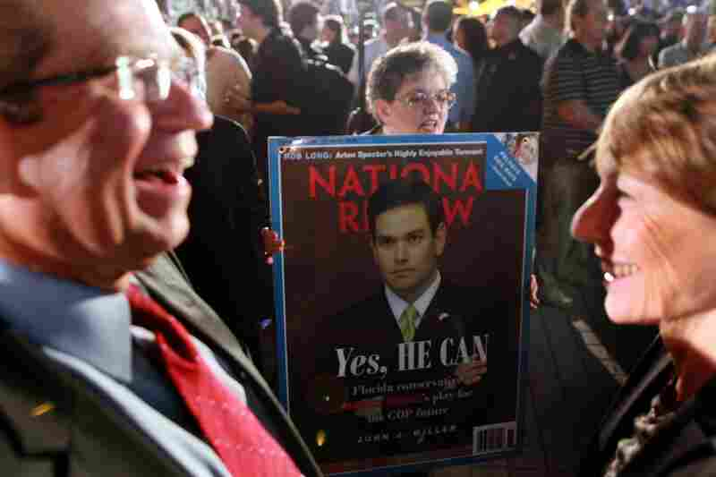 """A supporter of Florida Republican Marco Rubio waits for him to arrive for his """"Reclaim America Victory Celebration"""" in Coral Gables, Fla."""