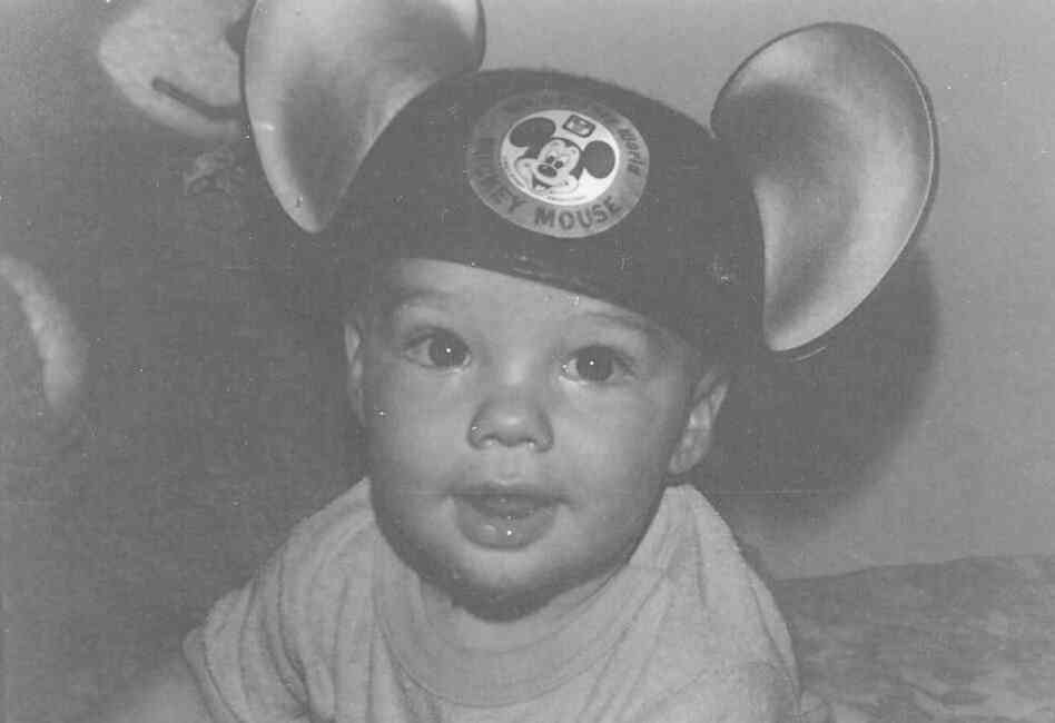 """A photo of our son, at age 9 months, now 31! We love Mickey!"""