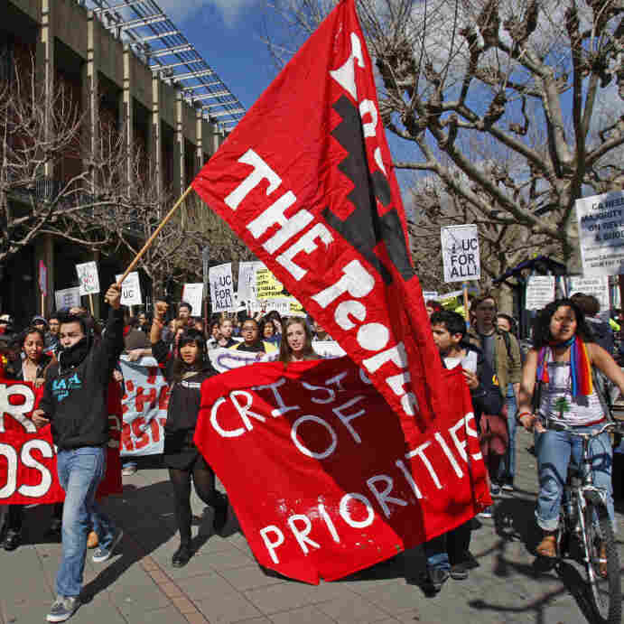 University of California at Berkeley students march to protest steep fee hikes and faculty furloughs