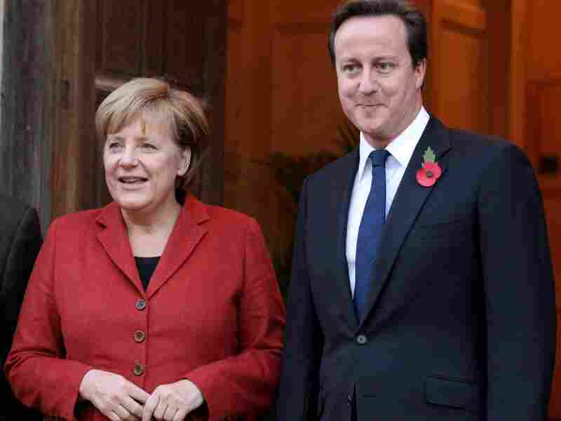 British Prime Minster David Cameron greets the German Chancellor Angela Merkel.