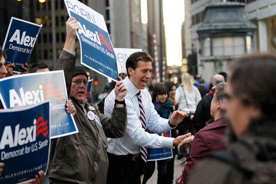 Illinois Democrat Alexi Giannoulias (center) greets commuters after voting in Chicago. Giannoulias lost the race for President Obama's former Senate seat to Republican Rep. Mark Kirk.