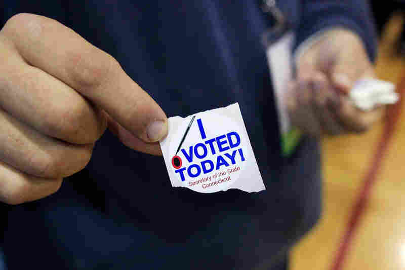 A poll worker handed out these stickers after voters cast their ballots at the North Street School in Greenwich, Conn.