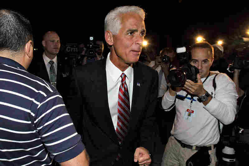 Florida Gov. Charlie Crist, a former Republican who ran for the Senate as an independent, makes his way to vote in St. Petersburg, Fla. Crist lost to Republican newcomer Marco Rubio.