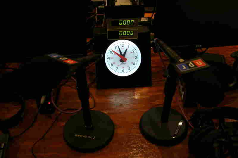 Close-Up of Newscast Table: The newscast unit sits right in the studio during special election night coverage. These are the mics where newscasts are broadcast from with the clock in clear view to ensure they hit their time posts.