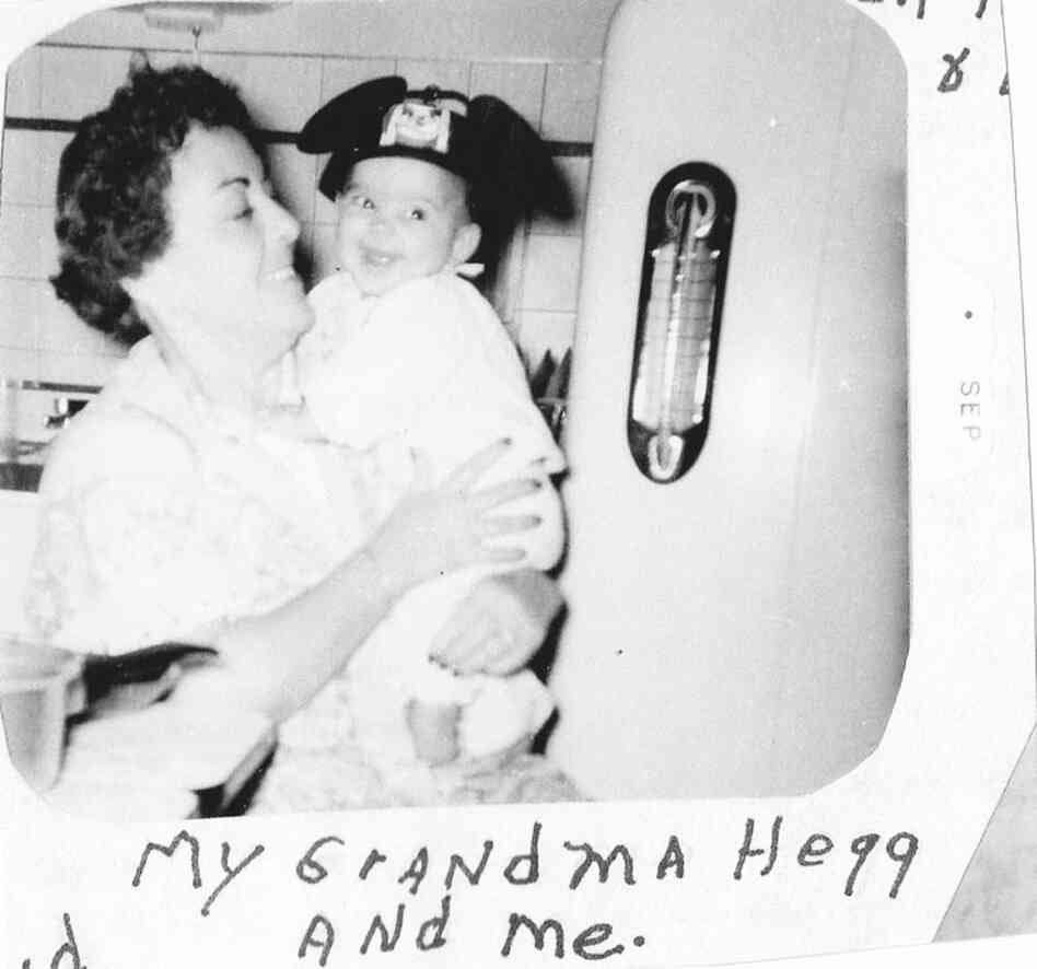 """This picture was taken with my Grandma Hegg, Aug. 1956. She had bought these Mickey Mouse ears for me. She died the following January, so this photo is very special to me."""