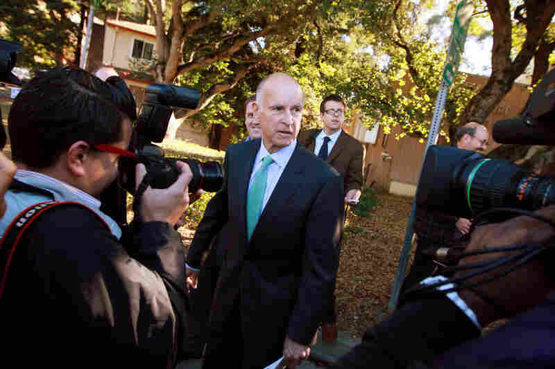 Jerry Brown, California's attorney general, talks to reporters after voting in Oakland. Brown won a bitter race against his Republican gubernatorial challenger, former eBay CEO Meg Whitman.