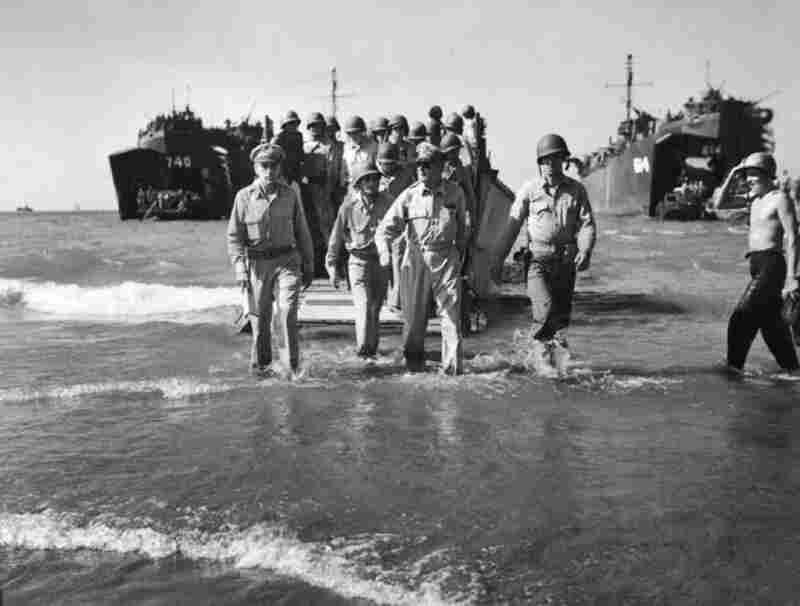 After being driven by the Japanese from the Philippines in the early days of World War II, General MacArthur (center) famously vowed to return. Almost three years later, in 1945, a photography-aware MacArthur made sure that Carl Mydans was there as he splashed ashore.