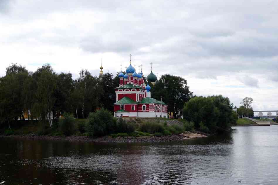A day after leaving Moscow, travelers can see colorful churches along the forested banks of the Volga.