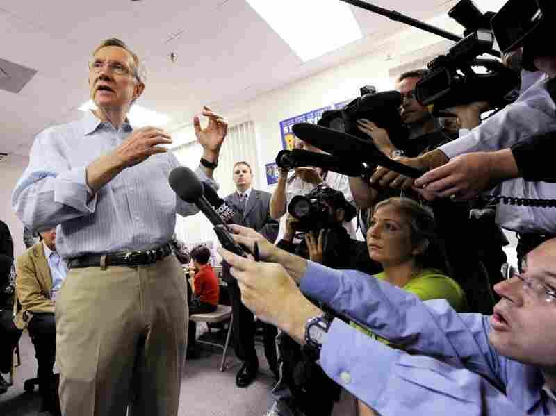 Harry Reid talks to the media