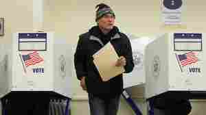 A voter walks away from a booth after marking his ballot at a Manhattan polling place.