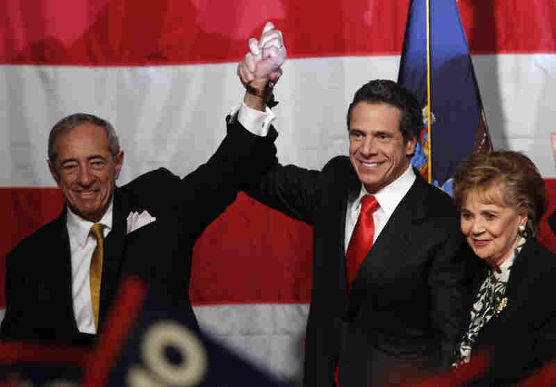 Although a Democrat, New York Governor-elect Andrew Cuomo (center) pledged to cap property-tax rates, appealing to Republican voters.