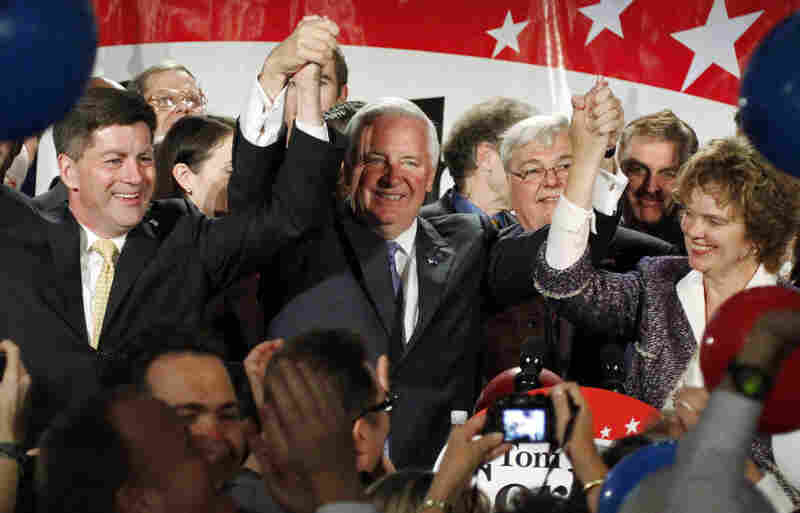 Pennsylvania Gov.-elect Republican Tom Corbett (center) and his wife, Susan (right), celebrate with Lt. Gov.-elect Jim Cawley (left) after defeating Democrat Dan Onorato.
