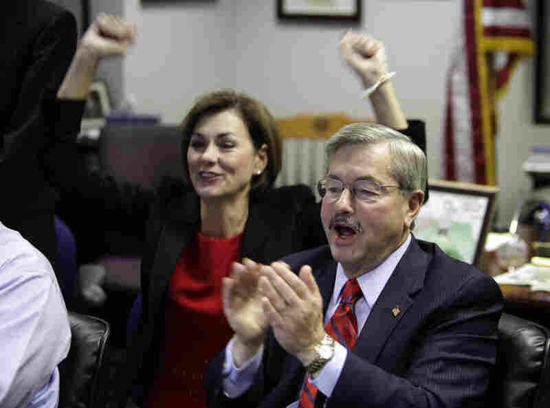 Iowa Republican gubernatorial candidate Terry Branstad and his running mate Kim Reynolds react to victorious election returns.
