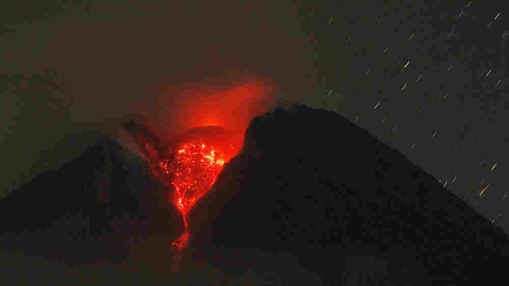Lava glows in the crater of Mount Merapi
