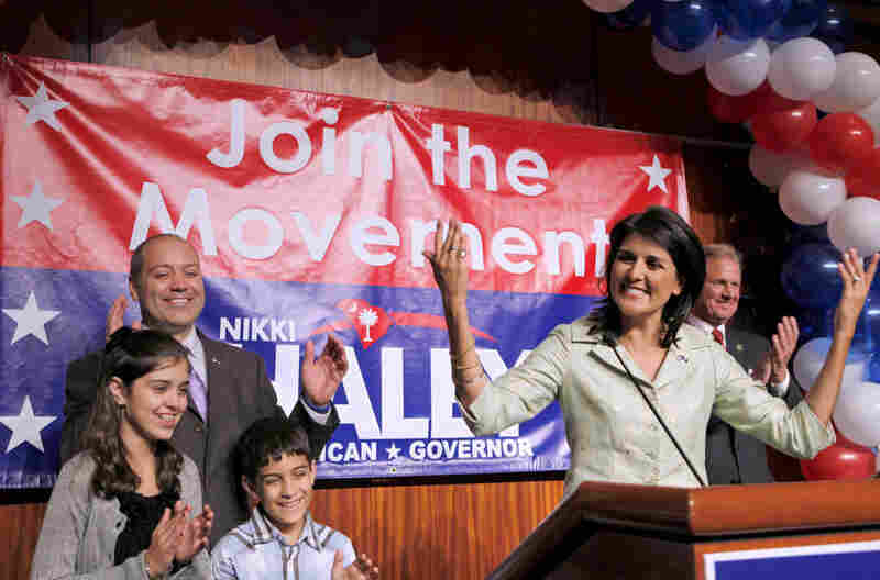 Surrounded by her family, South Carolina Gov.-elect Nikki Haley (right) gives her acceptance speech.