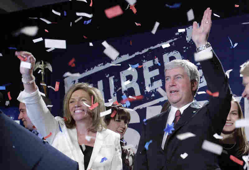 Michigan Gov.-elect Rick Snyder (right) and Michigan Supreme Court justice-elect Mary Beth Kelly wave at GOP supporters in Detroit.