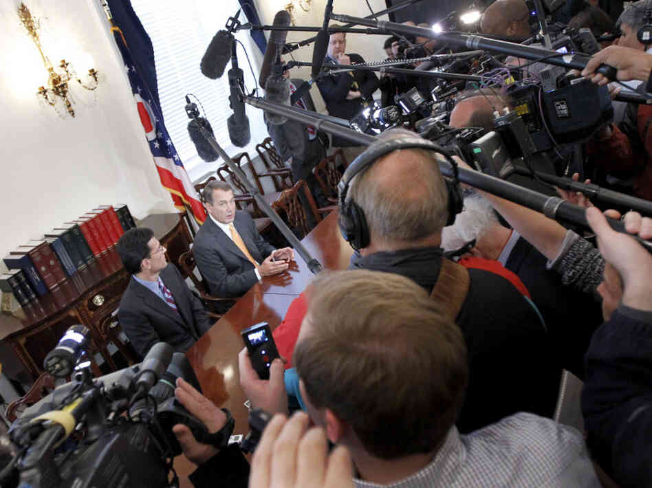 John Boehner and Eric Cantor are surrounded by cameras Wednesday on Capitol Hill.