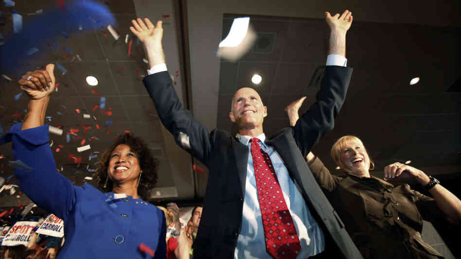 Rick Scott, Ann Scott, Jennifer Carroll